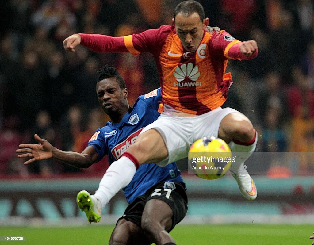Umut Bulut (R) of Galatasaray is in aciton against <a gi-track='captionPersonalityLinkClicked' href=/galleries/search?phrase=John+Boye&family=editorial&specificpeople=7190220 ng-click='$event.stopPropagation()'>John Boye</a> (L) of SAI Kayserispor during the Turkish Spor Toto Super League soccer match between Galatasaray and SAI Kayseri at Turk Telekom Arena in Istanbul, Turkey on February 27, 2015.
