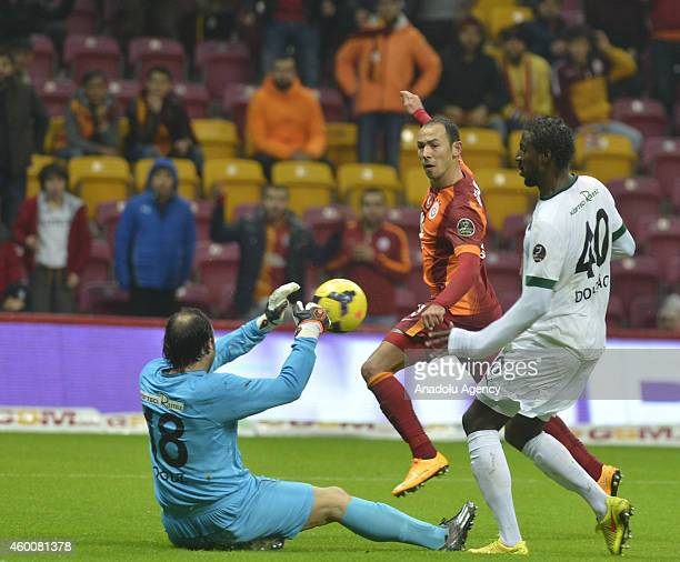 Umut Bulut of Galatasaray vies with Douglas Ferreira of Akhisar Belediyespor during Turkish Spor Toto Super League football match between Galatasaray...