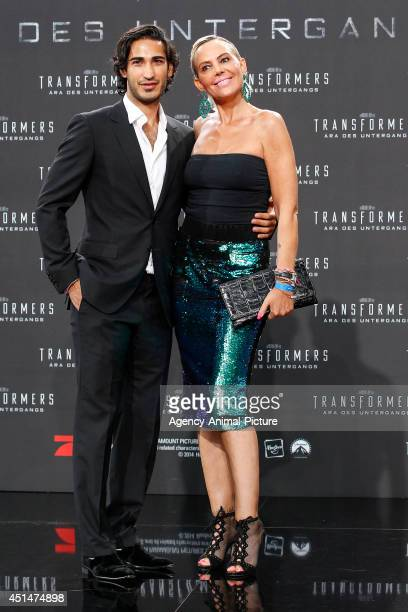 Umut Kekilli and Natascha Ochsenknecht attend the 'Transformers Age of Extinction' Berlin Premiere on June 29 2014 in Berlin Germany