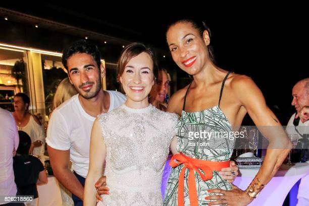 Umut Kekilli German actress Maike von Bremen and German presenter Annabelle Mandeng during the Remus Lifestyle Night on August 3 2017 in Palma de...