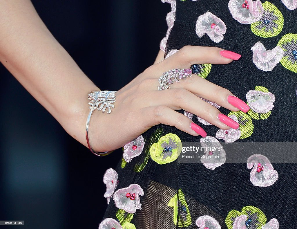 'Un Certain Regard' jury member Zhang Ziyi (jewelry detail) attends the 'Zulu' Premiere and Closing Ceremony during the 66th Annual Cannes Film Festival at the Palais des Festivals on May 26, 2013 in Cannes, France.
