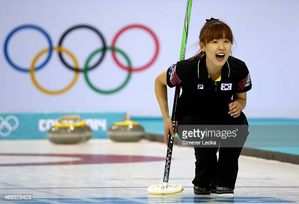 Un Chi Gim of Korea competes against China during the Women's Curling Round Robin match on day seven of the Sochi 2014 Winter Olympics at Ice Cube...