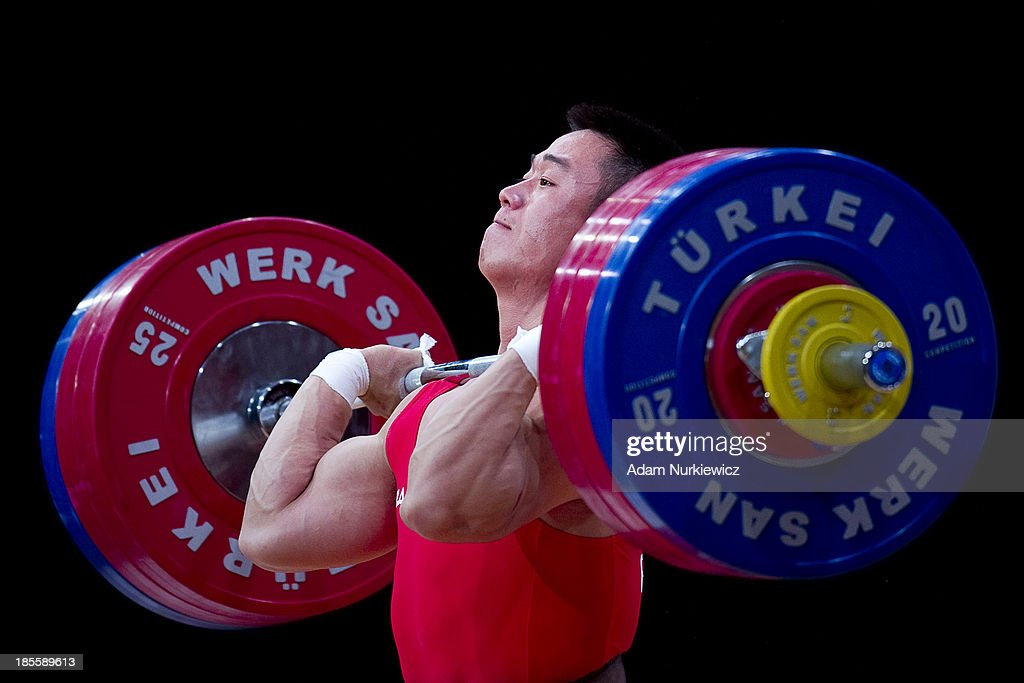 Un Guk Kim from North Korea lifts in Clean and Jerk competition men's 62 kg Group A during the IWF World Weightlifting Championships at Centennial Hall on October 22, 2013 in Wroclaw, Poland.