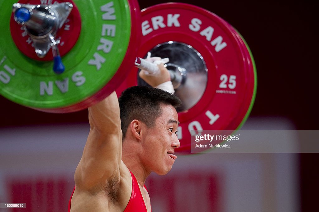Un Guk Kim from North Korea lifts in Snatch competition men's 62 kg Group A during the IWF World Weightlifting Championships at Centennial Hall on October 22, 2013 in Wroclaw, Poland.