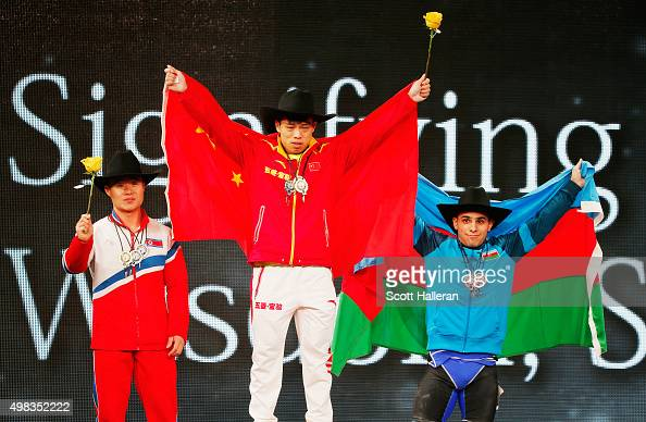 Un Guk Kim of North Korea Lijun Chen of China and Valentin Hristov of Azerbaijan pose on the podium after finishing with the higest total scores in...