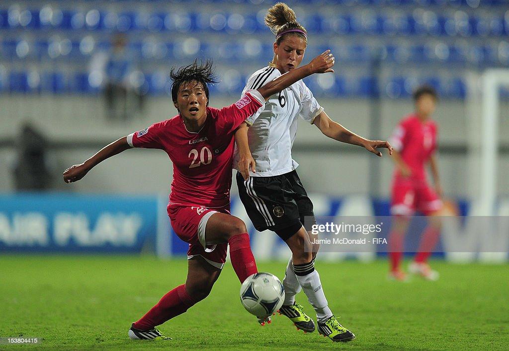 Un Sim Ri of Korea DPR battles with Daria Streng of Germany during the FIFA U-17 Women's World Cup 2012 Semi-Final match between Korea DPR and Germany at the 8KM Stadium on October 9, 2012 in Baku, Azerbaijan.