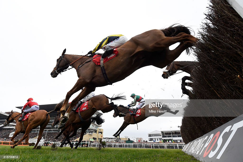 Un Temps Pour Tout ridden by Tom Scudamore jumps during the Ultima Handicap Chase on day one Champion Day of the Cheltenham Festival at Cheltenham...
