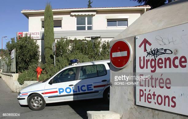 Un véhicule de police quitte le centre hospitalier d'AixenProvence le 03 janvier 2007 où est gardé à vue le comédien Samy Naceri après avoir été...
