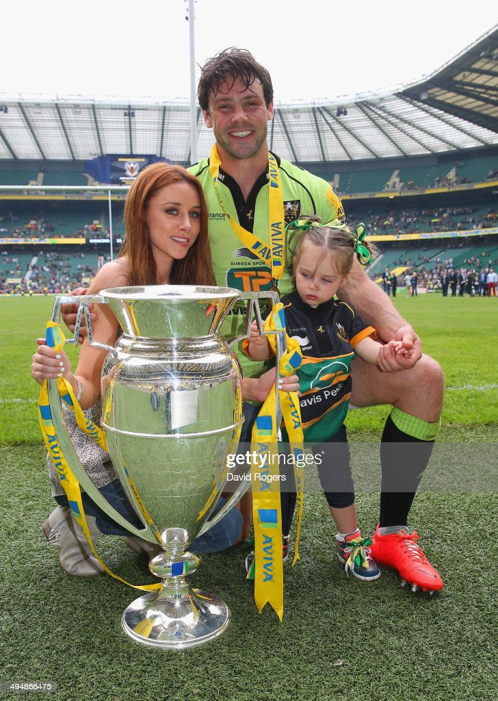 Una Foden poses with her husband <a gi-track='captionPersonalityLinkClicked' href=/galleries/search?phrase=Ben+Foden&family=editorial&specificpeople=542798 ng-click='$event.stopPropagation()'>Ben Foden</a> of Northampton Saints and their daughter after the Aviva Premiership Final between Saracens and Northampton Saints at Twickenham Stadium on May 31, 2014 in London, England.