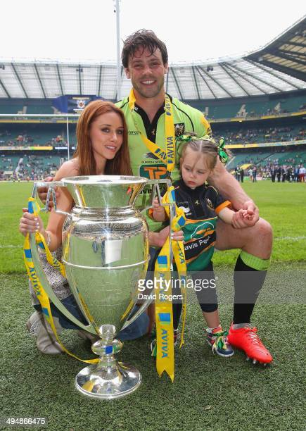 Una Foden poses with her husband Ben Foden of Northampton Saints and their daughter after the Aviva Premiership Final between Saracens and...