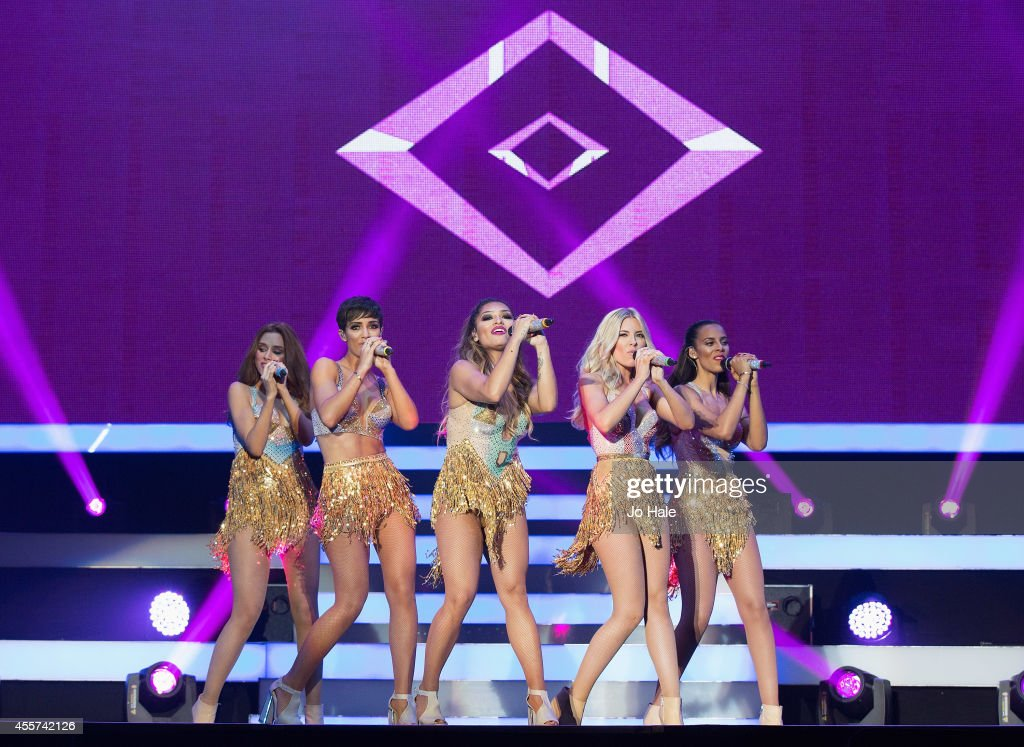 Una Healy Frankie Sandford Vanessa White Mollie King and Rochelle Humes of The Saturdays perform on stage at Wembley Arena on September 19 2014 in...