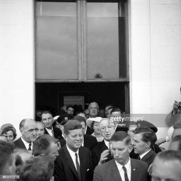 Unable to move forward or back owing to the crush of people wanting to shake his hand President JOHN F KENNEDY is surrounded by worried Gmen at a...