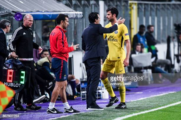 Unai Emery coach of PSG and Thiago Motta of PSG during the UEFA Champions League match between RSC Anderlecht and Paris SaintGermain at Constant...