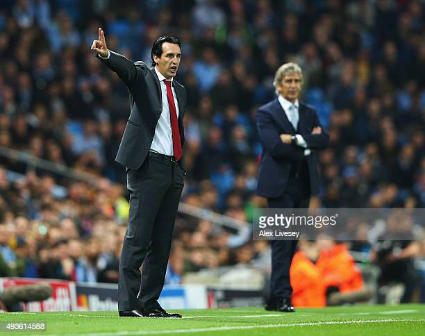 Unai Emery coach of Sevilla gives instructions with Manuel Pellegrini manager of Manchester City during the UEFA Champions League Group D match...
