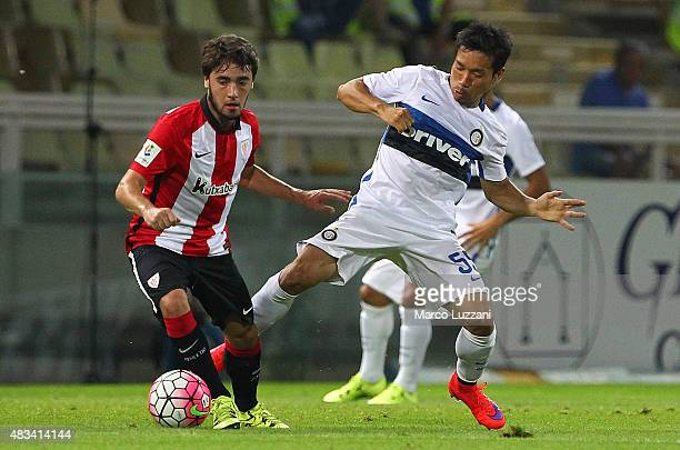 Unai Lopez of Athletic Club Bilbao competes for the ball with Yuto Nagatomo of FC Internazionale during the preseason friendly match between FC...
