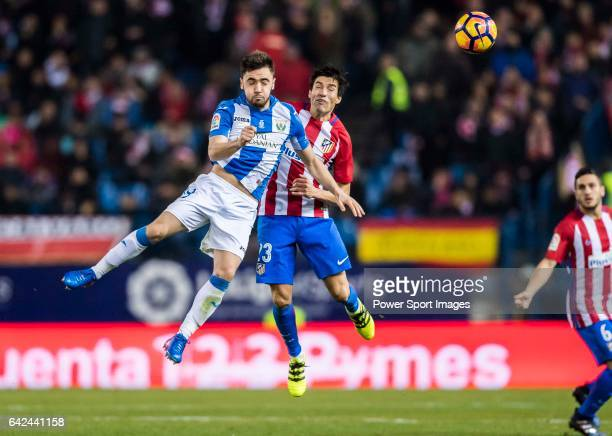 Unai Lopez of Deportivo Leganes competes for the ball with Nicolas Gaitan of Atletico de Madrid during their La Liga match between Atletico de Madrid...