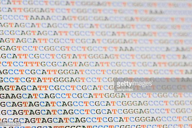 Unaligned DNA sequences letters on LCD screen