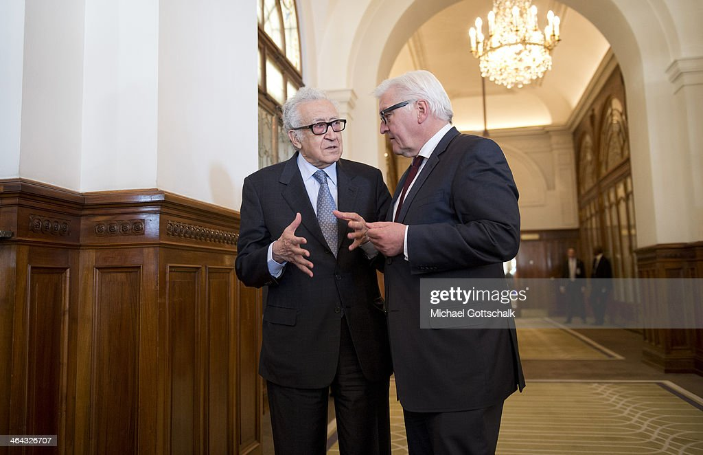 UN-Arab League envoy for Syria Lakhdar Brahimi (L) and German Foreign Minister Frank-Walter Steinmeier talk to each other at Geneva II Syria Peace conference on January 22, 2014 in Montreux, Switzerland.