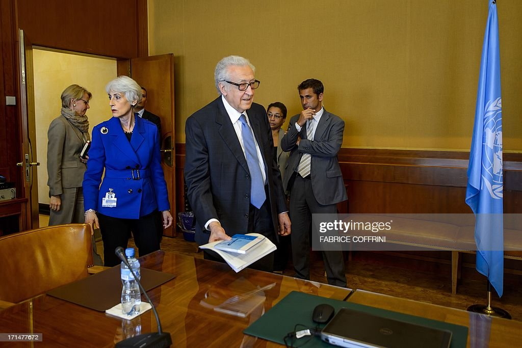 UN-Arab League envoy to Syria Lakhdar Brahimi (C), followed by US Undersecretary of State for Political Affairs Wendy Sherman (L), arrives prior to a second meeting on June 25, 2013 at the United Nations (UN) office in Geneva in a bid to organise the conference on Syria. A widely anticipated peace conference for Syria will probably not take place next month as hoped, UN peace envoy to Syria Lakhdar Brahimi said.