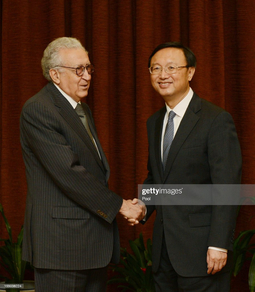 U.N.-Arab League peace envoy for Syria Lakhdar Brahimi (L) shakes hands with Chinese Foreign Minister Yang Jiechi prior to their meeting at the Ministry of Foreign Affairs on October 31, 2012 in Beijing, China. Brahimi is on a two-day visit to China.