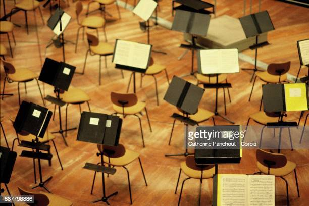 Unattended musicians stand on the stage of Berlin's Philharmonie built in 1963 by German architect Hans Scharoun on January 26 2003 in Berlin Germany