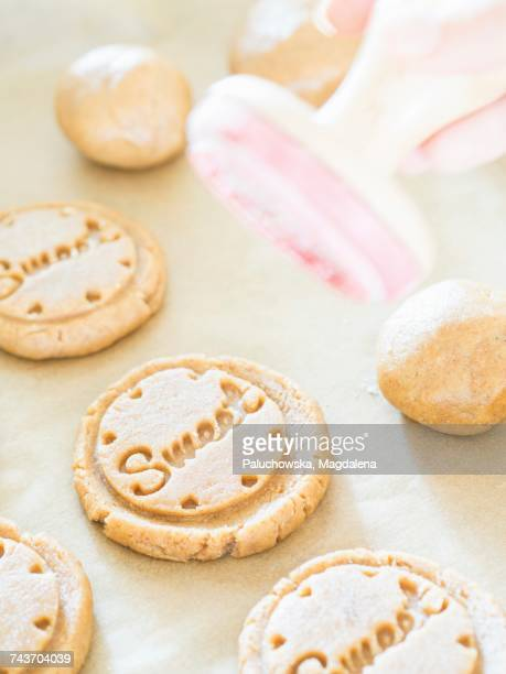 Unbaked cardamom biscuits stamped with the word Sweet