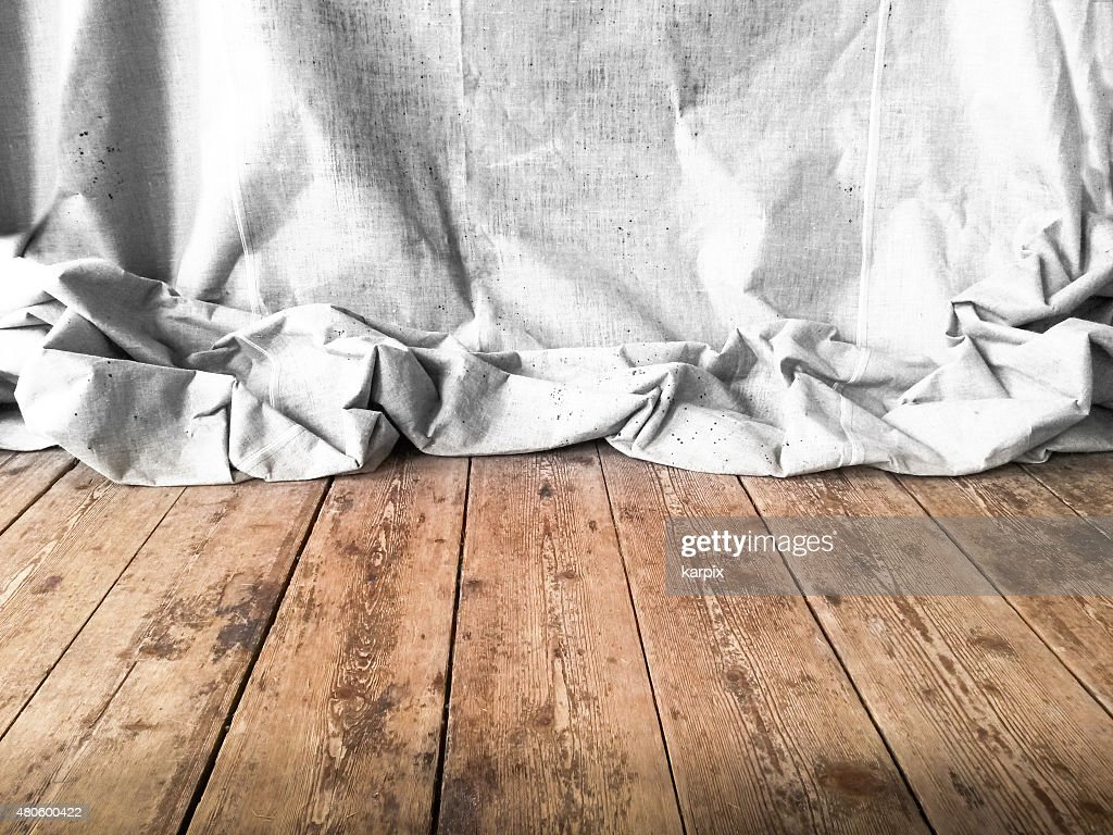 Unbleached textile on rustic floor : Stock Photo