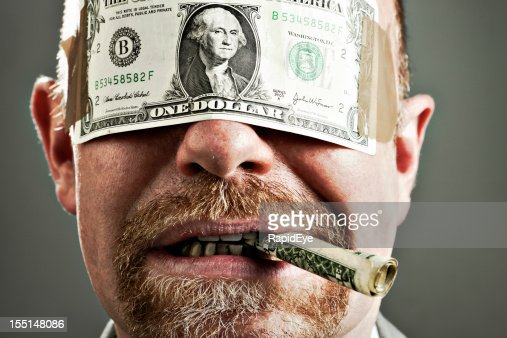 Uncaring Man Blindfolded By Dollar And Smoking Money