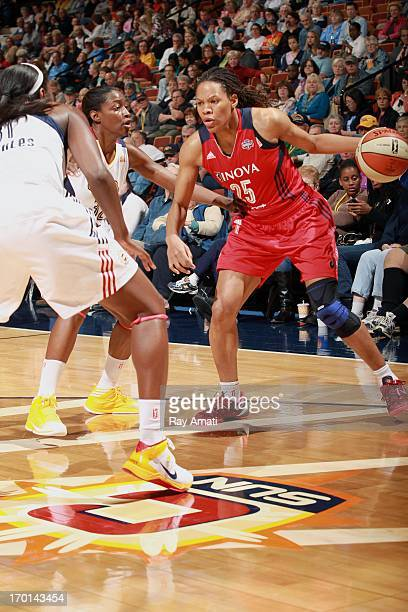 Monique Currie of the Washington Mystics drives to the basket against the Connecticut Sun during on June 7 2013 at the Prudential Center in Newark...