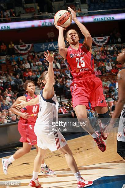 Monique Currie of the Washington Mystics shoots over the Connecticut Sun during on June 7 2013 at the Prudential Center in Newark New Jersey NOTE TO...