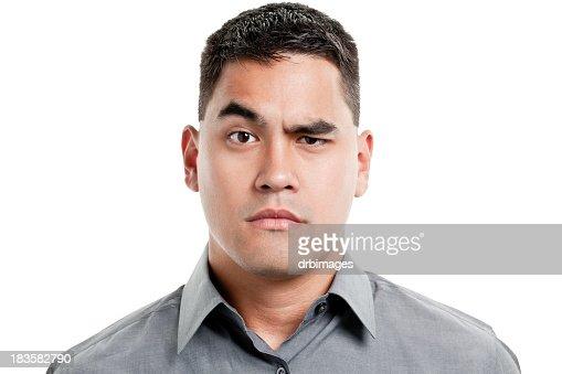 Uncertain Young Man Raises One Eyebrow