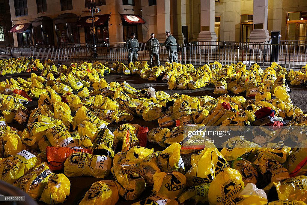 Unclaimed finish line bags are viewed near the scene of a twin bombing at the Boston Marathon, on April 16, 2013 in Boston, Massachusetts. Three people are confirmed dead and at least 141 injured after the explosions went off near the finish line of the marathon yesterday. The bombings at the 116-year-old Boston race, resulted in heightened security across the nation with cancellations of many professional sporting events as authorities search for a motive to the violence.