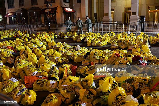 Unclaimed finish line bags are viewed near the scene of a twin bombing at the Boston Marathon on April 16 2013 in Boston Massachusetts Three people...