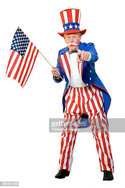 Uncle Sam holding American flag and pointing