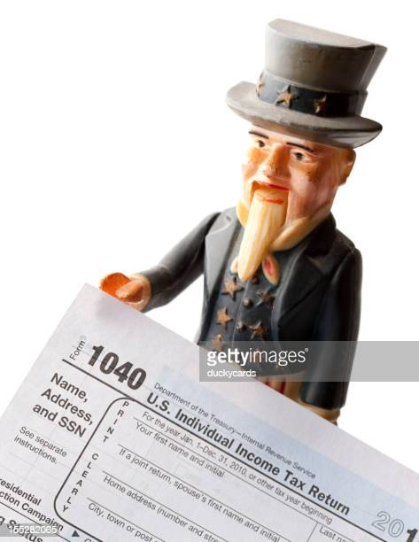 Uncle Sam with 1040 U.S. Tax Form