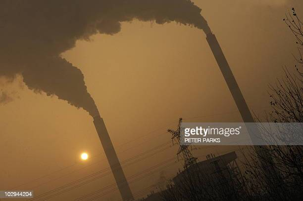 STORY 'UNclimatewarmingworldChinacoalFOCUS' by Robert Saiget This photo taken on December 8 2009 shows smoke belching from a coal powered power plant...