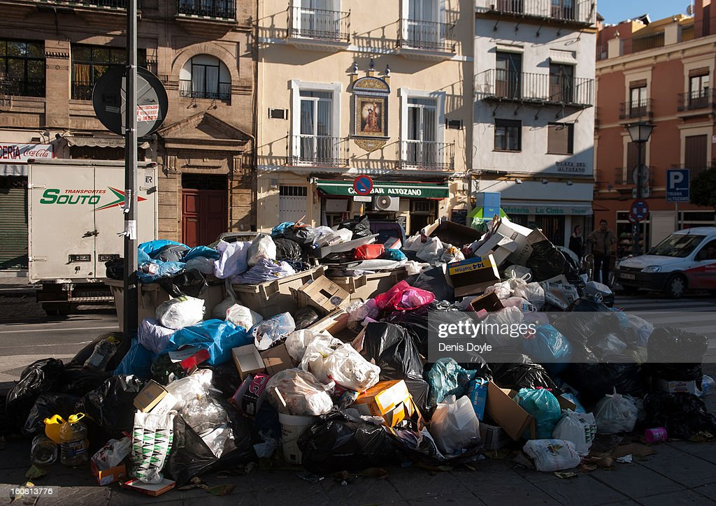 Uncollected garbage lies in a street during the 10th day of the Seville waste disposal strike on February 6, 2013 in Seville, Spain. Workers are striking over demands they take a 5% pay cut and extent their working week to 37.5 hours.