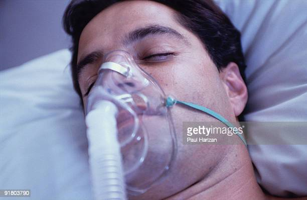 Unconscious patient with oxygen mask