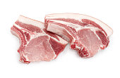 Two uncooked pork loin chops with ribs on a white background
