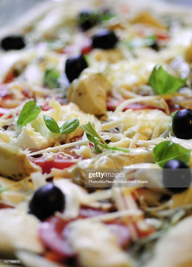 Uncooked Toppings On Fresh Pizza Closeup Stock Photo ...