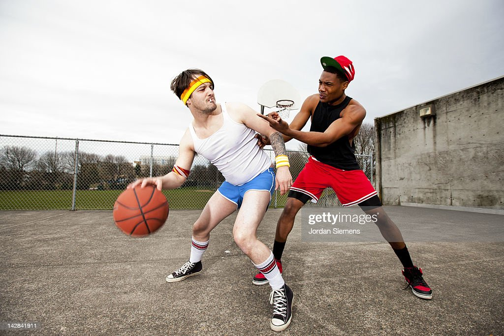 Uncoordinated man playing against an athlete. : Stock Photo