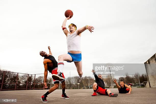 Uncoordinated man winning a basketball game..