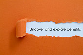 Uncover and explore benefits written under torn paper.