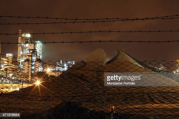 Uncovered mineral depots outside the fence of the Cementir plant photo shooted Taranto Italy December 2008