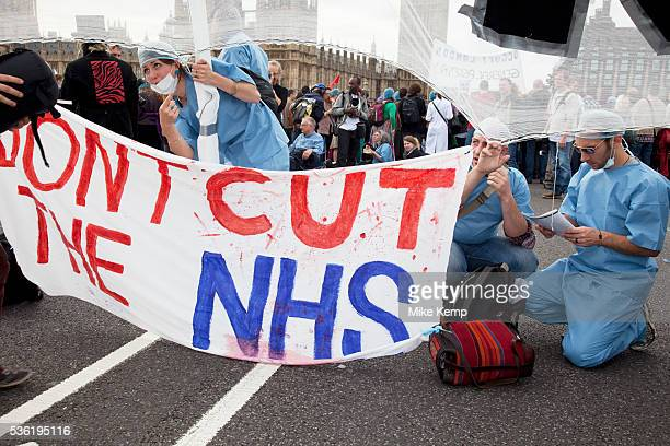 UK Uncut shut down Westminster Bridge in a protest over NHS bill Thousands of protesters occupied one of London's most iconic landmarks on 9 October...
