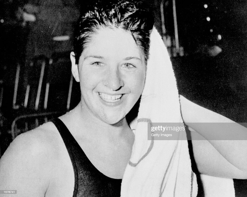 A portrait of Dawn Fraser of Australia, considered to be the greatest swimmer in the world from the late fifties until her enforced retirement after the Olympic Games in 1964. She won the 100 metres free style title in three successive Games, 1956 to 1964 and altogether took eight Olympic medals. Her individualism led her into many brushes with the establishment, and a prank at the Games in Tokyo brought her a ten year suspension. This was subsequently reduced to four, which many felt was still harsh. She was among a group who tried to enter the Emperor's Palace in the centre of Tokyo to +win+ a souvenir flag. She was arrested, but charges were not pressed and the Emperor sent her a flag. The Australian Swimming Federation did not take such a generous attitude to the incident and their suspension brought her career to an end.