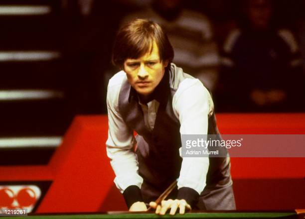 Alex ''Hurricane'' Higgins of Northern Ireland studies the table during a competition Mandatory Credit Adrian Murrell/Allsport