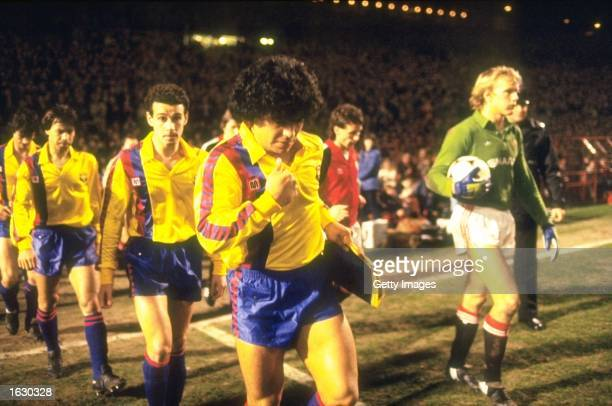 Diego Maradona of Barcelona leads the team out onto the pitch before a match against Manchester United at Old Trafford in Manchester England...