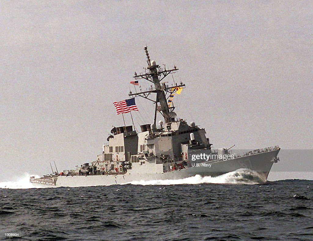 Undated file photo of a Navy Guided Missile Destroyer USS Cole (DDG 67). The Defense Department said the ship was attacked by a terrorist suicide mission during the early morning hours of October 12, 2000. An explosives-laden rubber raft slammed into a U.S. Navy destroyer and exploded in the Yemeni port of Aden, killing four U.S. sailors and injuring 31, five seriously. Reports indicate that the explosion caused a 20 by 40 foot gash in the port (left) side of the ship.