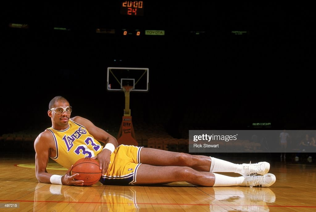 Kareem Abdul- Jabbar of the Los Angeles Lakers poses for the camera as he lays on the court. Mandatory Credit: Rick Stewart /Allsport